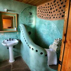 Bathroom in an earthship, just beautiful!