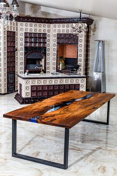 """A large dining table in the style of the River from solid wood and epoxy resin with a blue tint. Wooden slabs of Karpinus with a very beautiful texture and a natural, """"live"""" edge. Legs - metall. Size - 300 x 100 x 75 cm"""