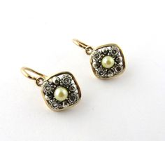 Antique Victorian 18K Yellow and White Gold Pearl Earrings with Rose Cut Diamonds  1.9 dwt  3.0 g  3.8 wide by 5/8 long  The earrings hinge on the
