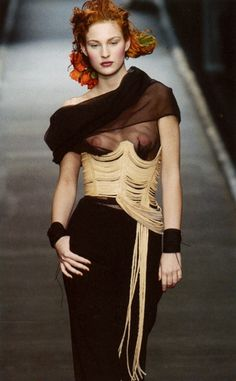 Jean Paul Gaultier 2001 corset ensemble  The placement of the corset and the lack of corset over the breasts resembles the bodice of the Minoans which is open to the breasts.
