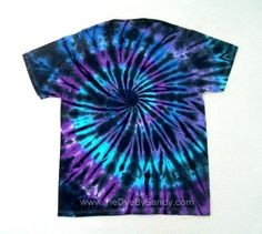 This is a very unique tie dye shirt that is sure to turn heads. It features dark velvety dye that is broken up by streaks of Moon Shadow colors- shades of blue and purple.    This is a one of a kind, hand dyed shirt. I use Fiber Reactive Dye to ensure the finest quality & brightest colors possible. New, 100% Cotton, Colorfast & Pre-Washed. The design is the same on both sides of the shirt. Available in adult sizes Small-4XL. And child sizes Small-Large.  If you love this shirt but arent sure…