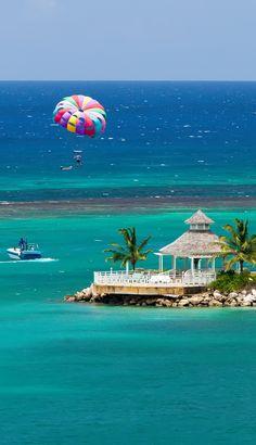 Parasailing over the tropical island of Ocho Rios, Jamaica