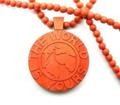 Red Wooden World Is Yours Pendant with a 36 Inch Beaded Necklace Good Chain JOTW. $9.95. Great Quality Jewelry. 100% Satisfaction Guaranteed!