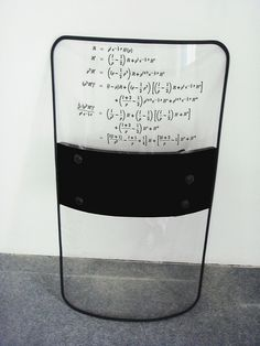 Riot: Riot shield with complex mathematical equation used in financial markets containing derivative investment instruments. (no link to artist)