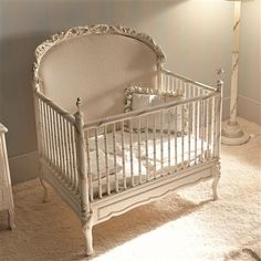 The back of this crib becomes a headboard. Beautiful!