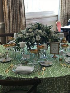 Pops of green.   Make for a crisp summer wedding