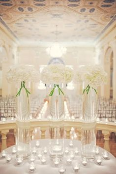 Clean and crisp white floral centerpieces  {Wedding Planning: www.ashleybaberweddings.com}