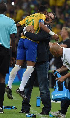 Brazil's forward Neymar celebrates with Brazil's coach Rogerio Micale after…