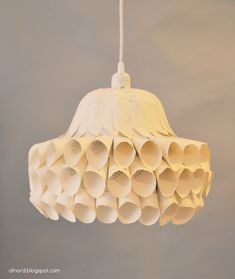 #BeautifullyUpcycled - This lamp made from scrolled pages of paper is quite structural and modern.