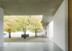 """David Chipperfield's Fayland House conceived as a """"large earthwork"""" in the English countryside."""