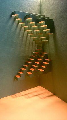 Dobleces paralelos al eje de simetría varios niveles de volumen