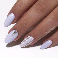 Pastel Lilac Acrylic Nail Design #pastelnails We have acrylic nail designs for short and long nails in a coffin, almond, square, and other nail shapes. Matte, glitter, designs with rhinestones. #naildesigns #acrylicnails #nailsart #glaminati #lifestyle