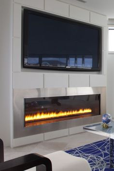 HDTV above a sleek fireplace (Montigo Fireplace)