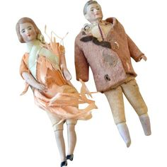 "Pair of German dollhouse dolls. Bisque heads, arms and legs. Both have issues- her clothing is disintegrating, he has missing feet. He does have two hands (one  under the sleeve). The dolls are hand painted and their bodies are hand stitched and intact. She- 4 3/4"" tall, he- 4 5/8"" (no feet). I purchased this pair mainly for the handsome male doll who has fine, thumbed hands. It is hard to find nicely featured antique bisque dollhouse dolls. I need to find him replacement feet/clothes."