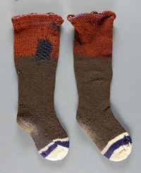 Philadelphia Museum of Art - Collections Object : Child's Socks - Child's Socks    Made in Arthur, Illinois, United States, North and Central America  c. 1900-1920    Artist/maker unknown, American, Amish. From the family of Mrs. Ida S. Beachy, American (Arthur Illinois).    Wool knit  7 1/2 x 4 inches (19.1 x 10.2 cm) - Square heels, darning, wear (LOVE!), and round probably starting/ending at side of foot.