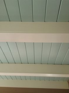 a little bolder with Benjamin Moore's Woodlawn Blue, as seen on this porch ceiling.