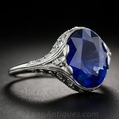4.89 Carat Ceylon Sapphire, Platinum and Diamond Art Deco Ring. A richly saturated, vibrant royal blue, oval faceted sapphire, weighing just shy of 5 carats (4.89 to be exact), sits close to the hand in this truly stunning and exemplary Art Deco ring, expertly hand fabricated in platinum during the pinnacle of the design period - circa 1925. With a master's attention paid to each and every detail, diamond-set platinum curves seamlessly flow from the shank to the sapphire...