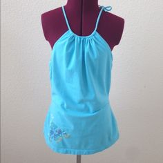 Halter top Really cute top w/ sequins details. Halter neckline with adjustable tie string. Material is 95%cotton and 5% Elastane. Color is in the shade of aquamarine. Size medium but fits like a small. Tops