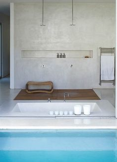the oh wow bathroom (sunken tub, double open shower, stucco, and a pool?)