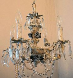 Distressed crystal chandelier lighting heavily by AnitaSperoDesign