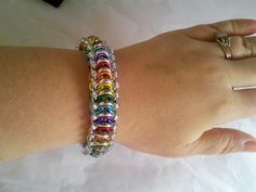 Rainbow glass caterpillar glass and chainmaille by galiam34jewelry
