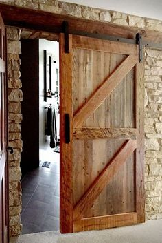 Barn doors in the house, sliding barn door, modern barn door design, rustic Thin Stone Veneer, Barn Door Designs, Design Industrial, Stone Interior, Interior Design, Rustic Bathroom Decor, Stone Houses, Interior Barn Doors, Craftsman Interior