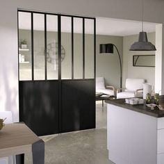 Séparation cuisine ouverte sur le salon avec une verrière Castorama