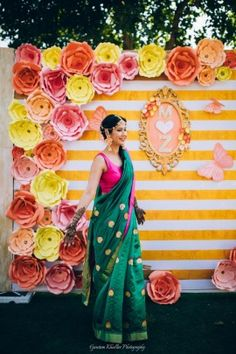 Mehendi Decor - Bride in a Green Saree with a Fuchsia Pink Blouse and Floral Decor | Zorawar & Mallika wedding story | WedMeGood #wedmegood #indianbride #indianwedding #bridal #mehendioutfit #mehandi #mehendidecor #decor #floraldecor