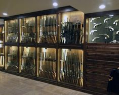 Discover the top 100 best gun room designs featuring cool armories you'll want to acquire. Explore traditional cabinetry to modern shelving security. Weapon Storage, Gun Storage, Hidden Gun Rooms, Gun Safe Room, Gun Closet, Closet Safe, Reloading Room, Gun Vault, Summer Door Wreaths