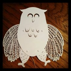 My hand cut paper owl toy prototype