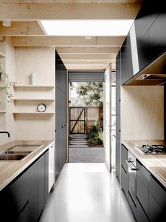 Black cabinetry with blonde wood