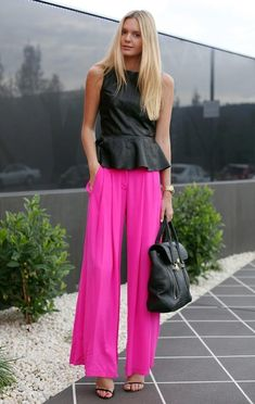 In love with this outfit! Black peplum top + Fucsia pants + golden accesories