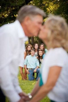 Parents kissing children watching Family Photo Shoot Idea