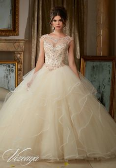 Morilee Vizcaya Quinceanera Dress 89116 PEARL AND CRYSTAL BEADING ON FLOUNCED TULLE BALL GOWN Matching Bolero Jacket. Available in Champagne/Blush, Peacock/Turquoise, White (Color of this dress): Champagne/Blush