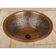 "With intricate and graceful scroll detail, this first-class copper sink easily complements many different styles of decor. It is a perfect fit for any bathroom. | 18"" Scrolled Copper Sink 