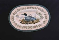 """HAND PRINTED LOON NESTING RUG - This rug has been hand printed with as many as ten different colours! Detailed images with unparalleled shading and colour sets the standard for this beautiful rug. 20"""" x 30""""."""