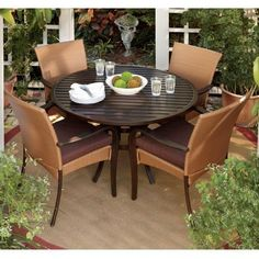 """Bella Five piece Dining Set, FIVE PIECE, RAFFIA JAVA by Home Decorators Collection. $1049.99. Arm Chairs: 36""""H x 22.5""""W x 25""""D.. Dining Table: 29.5""""H x 48"""" diameter.. Seamlessly crafted of cast aluminum and wicker, the Bella Five-Piece Dining Set will look amazing in your outdoor scenery year after year. You and your friends will love to gather around the dining table and share great meals and memories. Set includes dining table and four arm chairs. Each piece featu..."""