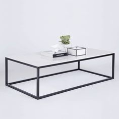 The Max Rectangular Coffee Table Is Made With A White Italian Carrara Marble Top On