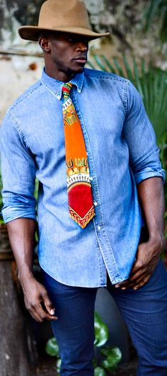 him an African print tie when you want his look to match yours! The Pumpkin Spice Java Tie is the perfect gift for him! African print necktie, dashiki print necktie, men's tie, gifts, gift for him - The Pumpkin Spice Java Tie. African Fashion Ankara, Ghanaian Fashion, African Inspired Fashion, African Print Fashion, Africa Fashion, Nigerian Fashion, African Prints, African Clothing For Sale, Traditional African Clothing