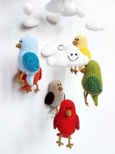 Crochet baby mobile with birds and clouds - colorful nursery decor. $90.00, via Etsy.