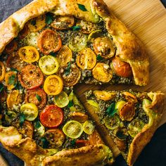 Make this easy savory galette with pesto, heirloom tomatoes, and a flaky crispy parmesan crust. Includes simple instructions for galette dough.
