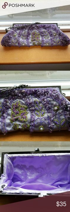 Purse Beautiful purple and green with white pearl embellishment.  A little snags on inside. Bags Clutches & Wristlets