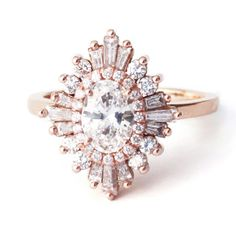 This Art Deco-inspired ring by Heidi Gibson alternates between baguette and round stones cascading at different levels to create a dazzling look.Related: 30  Vintage-Style Engagement Rings