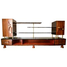 Frank Kyle Wall Unit Bookcase or Dry Bar | See more antique and modern Bookcases at https://www.1stdibs.com/furniture/storage-case-pieces/bookcases
