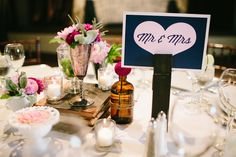 Love the oversized clothes pin as a stanchion for table numbers   seen on ruffledblog.com