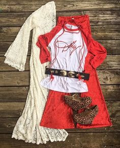 DATE NIGHT?!?!?! This is such a cute outfit!!! Perfect for VALENTINES DAY!!!  Custom red glitter DOLLY RAGLAN tees $34 S, M, L, XL & 2XL >> Daphne Ivory Lace Duster $29 THREE LEFT in M/L >> Ruby Red Crushed Velvet Bells LAST PAIR $24 size Small >> Leopard Mary Jane Wedge Heels $19 >> Saddler Antique Concho Belt in Gold >> Trixie RED faux Braided Leather & Feather Wrap Choker $16