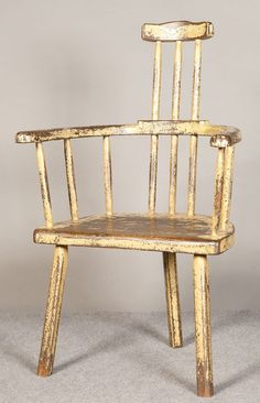 An unusual 3 legged painted country elbow chair with high comb back. Paint well worn but adds to character, shabby chic, possibly Welsh.