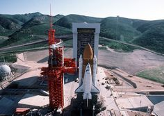High angle overall view of Space Shuttle Enterprise in launch position on the Space Launch Complex (SLC) during the ready-to-launch checks to verify launch procedures at Vandenberg Air Force Base, California on February (Tech. Space Shuttle Enterprise, Vandenberg Air Force Base, Johnson Space Center, Space Launch, Kennedy Space Center, Air Force Bases, Space Program, Space Travel, Space Exploration