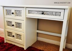 Awesome desk makeover! The panels on the front are tin look wallpaper!
