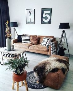 Nordic styled living room. Couch looks comfy!